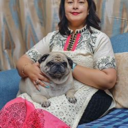 The Thapas and their Pug named 'Nano'